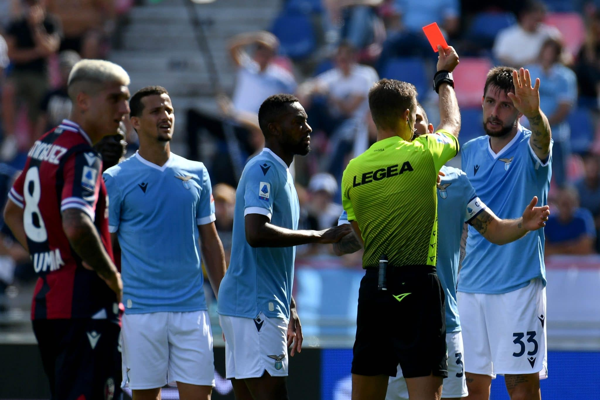 BOLOGNA, ITALY - OCTOBER 03: The refereee Daniele Massa show a red card Francesco Acerbi of SS Lazio  during the Serie A match between Bologna FC v SS Lazio at Stadio Renato Dall'Ara on October 03, 2021 in Bologna, Italy. (Photo by Marco Rosi - SS Lazio/Getty Images)