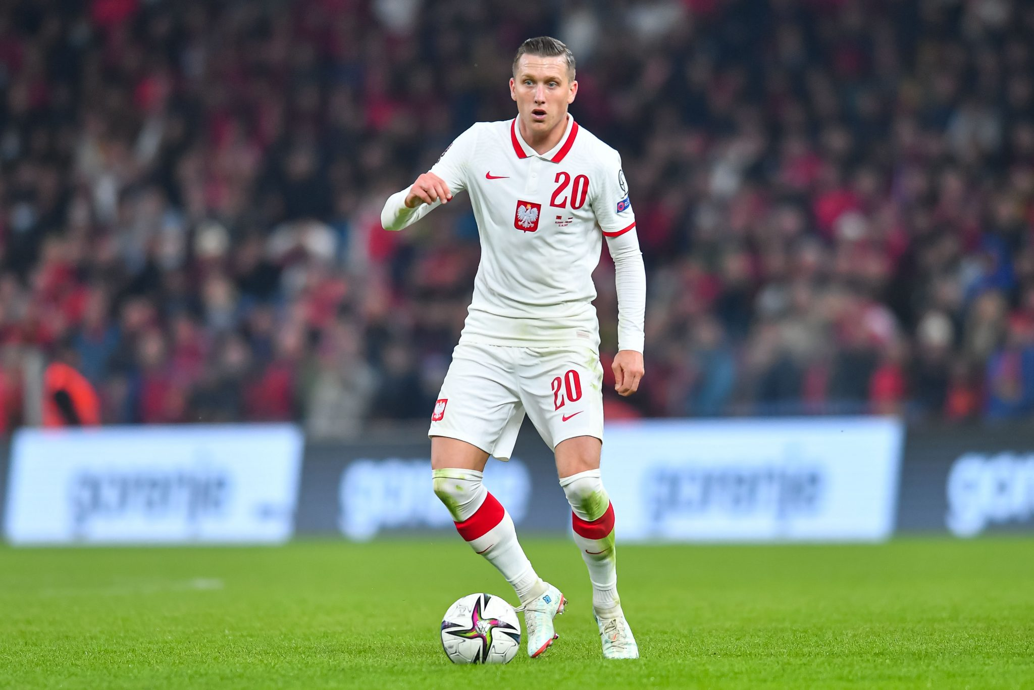 TIRANA, ALBANIA - OCTOBER 12: Piotr Zielinski of Poland in action during the 2022 FIFA World Cup Qualifier match between Albania and Poland at  on October 12, 2021 in Tirana, Albania. (Photo by PressFocus/MB Media/Getty Images)