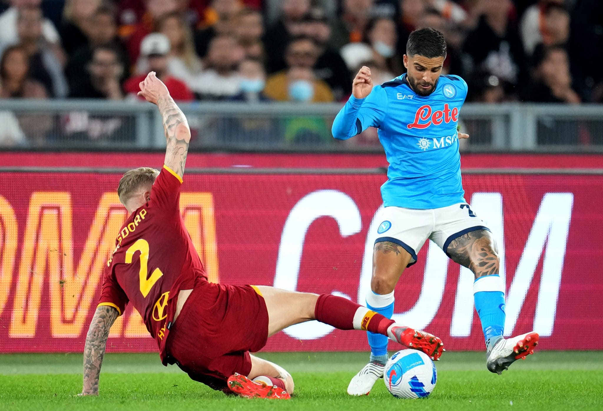 ROME, ITALY - OCTOBER 24: Lorenzo Insigne of SSC Napoli competes for the ball with Rick Karsdorp of AS Roma during the Serie A match between AS Roma and SSC Napoli at Stadio Olimpico on October 24, 2021 in Rome, Italy. (Photo by MB Media/Getty Images)
