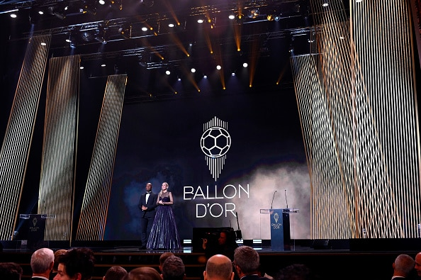 PARIS, FRANCE - DECEMBER 02: (L-R) Hosts Didier Drogba and Sandy Heribert are seen onstage during the Ballon D'Or Ceremony at Theatre Du Chatelet on December 02, 2019 in Paris, France. (Photo by Kristy Sparow/Getty Images)